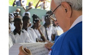 "Anthony ""Tony"" Pestritto traveled to Grand Boulage, Haiti, with Food For The Poor representatives to dedicate a school he built for more than 540 students. Above, he speaks at the dedication ceremony. Below, he helps cut the ribbon."