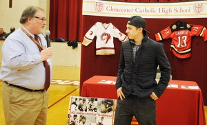 "Johnny ""Johnny Hockey"" Gaudreau, an NHL rookie standout on the roster for the Calgary Flames and a Gloucester Catholic High School graduate, listens as principal Edward F. Beckett speaks during an assembly to retire Gaudreau's jersey on March 2. Photo by Alan M. Dumoff"