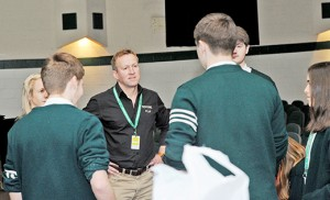 Pen Farthing, a former sergeant in the Royal Marines and founder of Nowzad Dogs and Soldiers' Animal Companions Fund, meets with students of Camden Catholic High School, Cherry Hill, on Feb. 23. Photo by Alan M. Dumoff