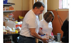Wayne Krause, Naval Mehta and Laura O'Sullivan, employees of Avnet Electronics, prepare lunch for the hungry at the Cathedral Pantry in Camden on April 10. As part of a group of volunteers for the company, Avnet Cares, the three and their colleagues, in addition to making lunch, donated $520 to the pantry. Photo by Peter G. Sánchez
