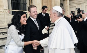 Pope Francis greets Nathalie and Matthew Dwyer at the Vatican last month while the couple was on their honeymoon. Formerly a parishioner of Transfiguration Parish, West Collingswood, (which became part of Most Precious Blood in 2012), Matthew is director of planned giving for the Diocese of Arlington, Va. Nathalie is a research associate at the Association of Land Grant Universities in Washington, D.C.