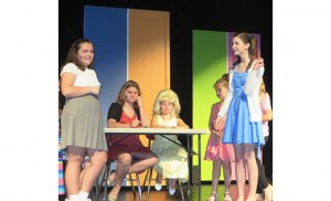Kendall DeVecchis, Olivia Marchei, Stephanie DiMeo and and Nicole D'Arecca act in the St. Michael the Archangel Regional School, Clayton, production of Hairspray Jr. at Glassboro High School on April 17.