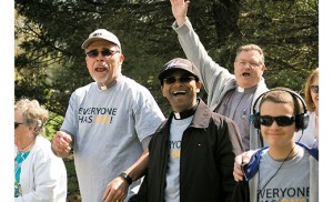 Deacon Gerard Jablonowski, Father Sanjai Devis and Deacon Joseph Kain, all from Church of the Holy Family, Sewell, feel good starting their 1.3-mile walk during the iRace4Vocations, which took place April 26, World Day of Prayer for Vocations, at Washington Lake Park in Sewell. Families came together for Mass with Bishop Dennis Sullivan, followed by a run/walk, picnic, and fun and games. Photo by James A. McBride