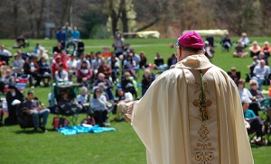 Top photo by James A. McBride Bishop Dennis Sullivan celebrates Mass for worshippers gathered on the grass at Washington Lake Park in Sewell at the iRace4Vocations on April 26. The family-oriented day, including Mass, race/walk and picnic, brought out a crowd of close to 1,200 in support of vocations. Photo below by Alan M. Dumoff, more photos ccdphotolibrary.smugmug.com - Runners are off on the 5K race.