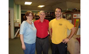Jeff Morris owner of Morris Graphics, a family-run printing company in Woodbury, is pictured with his wife Theresa and son Michael, who work with him.