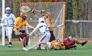 In high school boys' lacrosse action, visiting Gloucester Catholic defeated Paul VI 8-7 in Haddon Heights, on April 15. At left, both teams fight for possession in front of Gloucester Catholic's goal. Photo by Alan M. Dumoff, ccdphotolibrary.smugmug.com