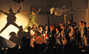 Taryn Hedley, as the boy from Neverland, dodges Captain Hook (Makayla Brennan) and flies across the Assumption Regional School stage in the Galloway school's production of Disney's Peter Pan Jr. on April 17. Photo by Alan M. Dumoff, ccdphotolibrary.smugmug.com