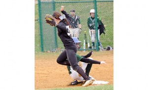 In high school girls' softball, a Camden Catholic player steals third base during a game against Bishop Eustace on April 10 in Cherry Hill. The hometown Fighting Irish defeated the Crusaders 2-1. Photo by Alan M. Dumoff