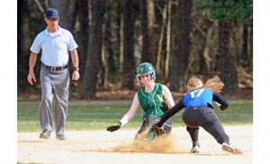 On April 13, the Wildwood Catholic Crusaders beat the home team of Our Lady of Mercy Academy Villagers in Newfield, 9-8, in girls' softball. Above, the Crusaders' Becky Andress attempts to make a tag on a Villager runner. Photo by Alan M. Dumoff, ccdphotolibrary.smugmug.com