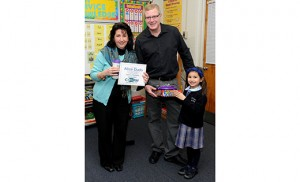 Alice Dudo, third grade teacher at St. Vincent de Paul School, Mays Landing, stands with WFPG-96.9 radio personality Eddie Davis and student Jessica Luciano, who nominated her teacher for Lite Rock Teacher of the Month earlier this year. In addition to teaching at St. Vincent de Paul, Dudo sent her six children there. Photo by Alan M. Dumoff