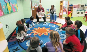 Children listen to a story at the inclusive pre-school and daycare program, Here We Grow, at St. John of God Community Services, Westville Grove. Of the 25 children in the program this year, eight have an autism spectrum disorder. Rates of autism spectrum disorder occurrence have increased every year since 2000, with New Jersey consistently reporting a rate higher than the national average.  Photo by Joanna Gardner