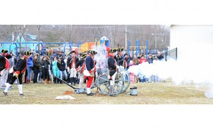 The West Jersey Artillery Company, made up of Revolutionary War enthusiasts, fire off Thundering Barbara, a reproduction of a cannon from the War for Independence, for students of St. Michael the Archangel School, Clayton, on March 24. Photo by Alan M. Dumoff