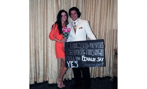 Dean Dugan, a senior at Bishop Eustace, Pennsauken, and a model at the school's March 26 fashion show, walked down the runway with a sign directed at senior Taylor Forrest, asking her to go to prom with him. She said yes. Photo by Maria D'Antonio