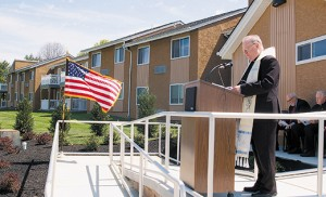 Bishop Dennis Sullivan blesses the Village Apartments of Cherry Hill on April 30 at a rededication ceremony, which brought together local clergy, community members, and members of the Camden Diocesan Housing Services Corporation. Built in 1983, the Village Apartments of Cherry Hill have 150 studio and one-bedroom units for low-income seniors and disabled residents. Recent improvements to the site have included new roofing, painting, carpeting, a community garden, and patios and decks attached to the studio apartments. Photo by James A. McBride