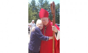 Sharon Fileccia hugs Bishop Dennis Sullivan following the fifth anniversary Mass of the parish of the Holy Spirit in Mullica Hill on Pentecost Sunday. Photo by James A. McBride