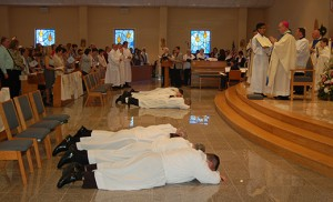Candidates prostrate themselves in front of Bishop Sullivan as the congregation joins in the Litany of Supplication.