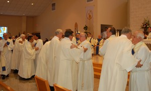 The entire diaconate congregation welcomes the newly-ordained.