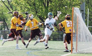 On May 4 in high school boys' lacrosse, Camden Catholic defeated visiting Gloucester Catholic, 7-6, in Cherry Hill.  Above, Camden Catholic's Adam Giordano goes for a shot against Gloucester Catholic's T.J. Logan. Photo by Alan M. Dumoff, ccdphotolibrary.smugmug.com