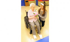 The Pen Pal Club of St. Michael the Archangel Elementary School in Clayton held a luncheon for their Senior Pen Pals Club on May 8, bringing together fourth, fifth and sixth graders with the senior citizens that they have been corresponding with throughout the year.  The students read poems, sang songs, and danced for their guests. In photo, senior Clara Mirenda with her pen pal, 11 year-old Savanna Snyder. Photo by Alan M. Dumoff