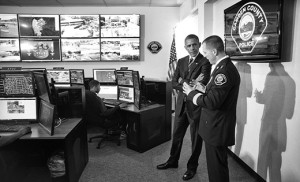 President Barack Obama, with Camden County Metro Police Chief J. Scott Thomson, takes a tour of the Real Time Tactical Operational Intelligence Center at Camden County Police Headquarters in Camden May 18. The facility includes technology to monitor crime hot spots, track patrol car position, and view live camera feeds throughout Camden.