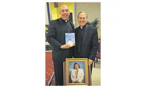 On April 27, Father Timothy Byerley and Father Cadmus Mazzarella spoke at St. Joseph High School, Hammonton, on Servant of God Maria Esperanza and the messages of Mary, Virgin and Mother, Reconciler of all Peoples and Nations in Betania, Venezuela, where Esperanza was the chief visionary. Left, Father Christopher Markellos, Director of Catholic Identity at St. Joseph, and Father Byerley, Vice-Postulator for the Beatification and Canonization Cause of Maria Esperanza, with Father Byerley's book on Esperanza. Photo by Alan M. Dumoff