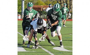 In high school boys' lacrosse on April 28, the visiting Camden Catholic Fighting Irish (Cherry Hill) defeated home team Bishop Eustace 12-11 in Pennsauken. Above, Bishop Eustace's Henry Morelli, flanked by Camden Catholic defenders, goes for the loose ball. Photo by Alan M. Dumoff, ccdphotolibrary.smugmug.com