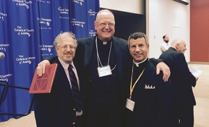 Father Joseph D. Wallace stands with Rabbi Lewis Eron from Cherry Hill and Cardinal Timothy M. Dolan of New York.