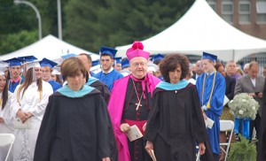 Bishop Dennis Sullivan walks with the faculty on the football field of Paul VI High School, Haddon Township, for the commencement ceremony on June 3. Below, he poses for photos with graduates of St. Joseph High School, Hammonton, on June 4. Also pictured are Father Christopher M. Markellos, Director of Catholic Identity at the school, and Father Michael M. Romano. Photo above by James A. McBride