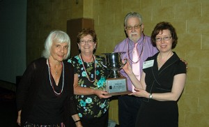 James Lanahan, director of the Camden Diocese's Office of Development, and Mary Kelly Finegan (right), coordinator of the House of Charity-Bishop's Annual Appeal, present the Bishop's Cup to representatives of St. Peter Parish, Merchantville, for its work on behalf of the House of Charity. Accepting are Erna Totoro, far left, and Elaine Brubaker. The House of Charity Parish Team Reports gathering was held June 23 at St. Charles Borromeo Parish, Sicklerville. Photos by James A. McBride The Dixie Kings jazz band welcomed parish representatives to the House of Charity meeting. The theme was Sullivan's Jazz Cafe and featured New Orleans style food.
