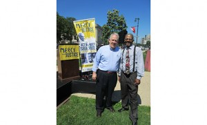 Kevin Hickey, left, executive director of Catholic Charities, Diocese of Camden, with Gregory Dunlap, a formerly homeless client who received services through Catholic Charities to get back on his feet.