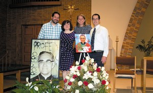 At the Sunday, June 1 English and Spanish Masses, St. Joseph-Pro Cathedral commemorated the recent beatification of Blessed Oscar Romero. With images of Blessed Romero are members of the Romero Center Ministries Staff: Jeff Petrosky (associate director), Teresa Reyes (Urban Challenge associate), Sister Julie Fertsch (Urban Challenge associate), and Patrick Cashio (executive director). Photo by James A. McBride