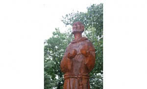 """A statue of St. Francis of Assisi is seen in the meditation garden adjacent to The Little Portion of Lourdes Wellness Center in Collingswood. """"Laudato Si',"""" the title Pope Francis chose for his encyclical on the environment, comes from a hymn of praise by St. Francis of Assisi that emphasizes being in harmony with God, with other creatures and with other human beings, said the head of the Franciscan order. Photo by James A. McBride"""