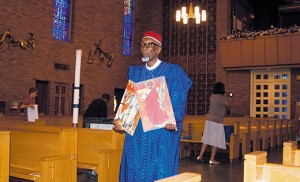 Abdullahi Suleiman carries images of the Ugandan Martyrs at the annual Mass remembering St. Charles Lwanga and his 24 companions, held June 6 at St. Rose of Lima Church in Haddon Heights. Photo by James A. McBride