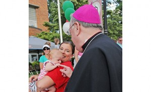 Top photo: Bishop Dennis Sullivan greets little Julianna Carmean, being held by her mother Ellanna. Members of the Our Lady of Mount Carmel Society ready a statue of Our Lady of Mount Carmel for the procession of images during the Society's 140th feast of Our Lady of Mount Carmel, held July 16 at St. Mary of Mount Carmel Parish, Hammonton. Photos by Alan M. Dumoff, ccdphotolibrary.smugmug.com
