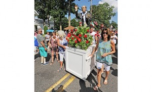 Faithful process down the Hammonton streets with a statue of St. Vincent Pallotti during the 140th annual Our Lady of Mount Carmel Festival on July 16. Photo by Alan M. Dumoff