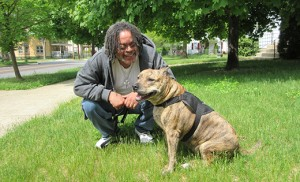 James Charles Branch IV and Charisma, his pit bull terrier, have been inseparable for eight years. Catholic Charities' Veteran Services program has been able to help Branch, a Navy vet, in a number of ways, including getting Charisma re-registered as a service dog. Photo by Joanna Gardner