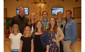 Father Michael Matveenko, pastor of Charles Borromeo Parish, Sicklerville, with Kathy (next to Father Michael) and Sean Ryan (far right), and their six children, who are, back row, Patrick and Matthew; and front row, Megan, Madison, Brittney and Kaitlyn. Photo by James A. McBride