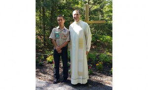 Father John Vignone, pastor of St. Katharine Drexel, Egg Harbor Township, stands with Vito Acosta, who, with the help of volunteers, created a prayer path at the parish for his Eagle Scout project.