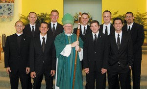 On Sunday, Aug. 9 at Christ the Redeemer Parish, Assumption Church in Atco, Bishop Dennis Sullivan accepted nine new seminarians for the Diocese of Camden who will begin studies this fall. In all, 19 seminarians for the diocese will be in formation this year, the largest number of men since 2000. The men with Bishop Sullivan, after the Mass of Acceptance, are, front row, Anthony Infanti, Steven Bertonazzi, Eric Gonnan, and Anthony McCullough; back row, John March, Stephen Robbins, Ryan Meehan, Christopher Myers, and Patrick Erdmann. Photo by James A. McBride