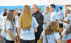 Bishop Dennis Sullivan speaks with participants in the Summer in the City at the Shore program. Photo by Alan M. Dumoff