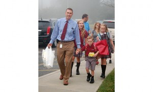 Students arrive at St. John Paul II School, Stratford. Photo by James A. McBride