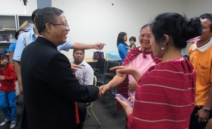 Bishop Felix Lian Khen Thang of the Diocese of Kalay in Myanmar speaks with Burmese refugees Sept. 21 at Catholic Charities' offices in Camden. Photo by Joanna Gardner