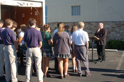 High school students bring food to the hungry through diocese-wide food relay