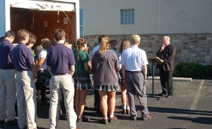 Bishop Dennis Sullivan blesses the students and the food they loaded on the Catholic Charities truck at the agency's Camden location on Sept. 14. A diocese-wide food relay in honor of Pope Francis transported a donation of food to six food pantries, covering all six southern counties served by Catholic Charities, Diocese of Camden. Students from diocesan high school volunteered at each stop. Photo by James A. McBride