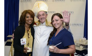"Pictured with ""Pope Frank"" (actor Richard Alliger) are Vitelese Hutton, left, and Amber Cutone, both of Our Lady of Lourdes."