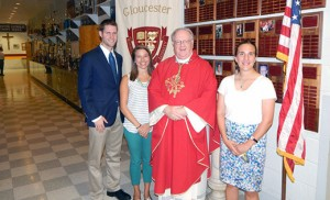 Bishop Dennis Sullivan stands with new Gloucester Catholic High School teachers Dan Satterfield and Jennifer Cush from the Alliance for Catholic Education at St. Joseph's University, and Megan Heeder from the University of Notre Dame Echo program.