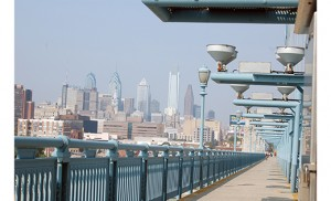 The Philadelphia skyline is visible from the Benjamin Franklin Bridge pedestrian walkway. Many people are expected to walk across the bridge for the papal Mass on Sept. 27. Photo by Carl Peters