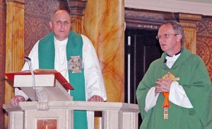 St. Joseph Church in Camden hosted a Mass and presentation on Polish Scouting on Aug. 23, led by Father Pawel W. Kryszkiewicz of St. Joseph, and Father Tomasz, vice rector of the Silesian Seminary, Lad nad Warta, Poland. After a 10:30 a.m. Mass, the two spoke on Polish Scouting and an exchange program between U.S. and Polish Scouts.  Poland Scouting badges and patches were also on display for youth.  Above, Father Tomasz addresses the scouting community as Father Kryszkiewicz looks on. Photo by Alan M. Dumoff, ccdphotolibrary.smugmug.com