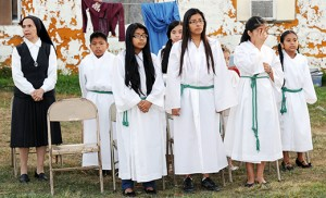 Sister Graciela Rosas stands with some of the altar servers during the Mass Bishop Dennis Sullivan celebrated at Larchmont Farms, Elmer, on Aug. 29. Photos by Alan M. Dumoff, /ccdphotolibrary.smugmug.com