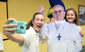 High School students Tarryn Slattery and Julia Dalzell from Holy Spirit, Absecon, and below, Caroline Smith and Cecilia Wigginton, from Camden Catholic), with cardboard Pope Francis. They will see the real, genuine, flesh-and-blood Pope Francis in Madison Square Garden on Sept. 25. Photo below by Peter G. Sanchez
